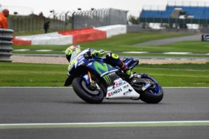 ......... as does his team mate at Yamaha, Valentino Rossi, pictured exiting the same corner