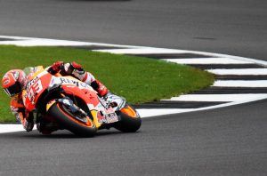 Marc Marquez adopts a typically severe lean angle on his Honda RCV...................