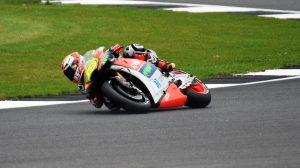 Marc Marquez adopts a typically severe lean angle..................