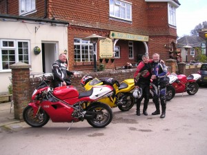 Johnny's 996 BiPosto, our yellow 996 Biposto, Peter's modified 916 Strada and Roger's 916 BiPosto outside the Three Oaks Inn